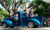 Mayor Trish Herrera Spencer and Husband Joel rode the parade route in a vintage stepside pickup. Photo by Adam Gillitt