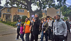 Jenya Cassidy &nbsp&nbsp Rasheed Shabazz, center, with megaphone, led the 39th annual march during the Martin Luther King Jr. Day celebration in Alameda.
