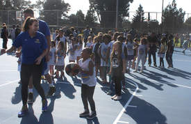 Ekene Ikeme &nbsp&nbsp&nbsp Alameda kids couldn't wait to take their turns at shooting hoops at Washington Park's newly refurbished basketball courts. The new courts were unveiled last Friday.