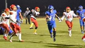 Photos by Charles Penalver &nbsp&nbsp Senior Isaiah Smith runs in a second-quarter touchdown.