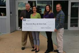 Courtesy photo  From left to right: CEO Jeff Miller, Alameda Boys & Girls Club; Lynda Robles, Safeco Insurance and Kerry and Bradford Walker of Mahoney Walker Insurance with a check the company earned for the club.