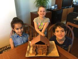 Robin Seeley  Leila, Abby and Roan show off an edible replica of Abraham Lincoln's birthplace on the 208th anniversary of the great statesman's birthday. The edible log cabin made of pretzel logs and molten chocolate calls to mind President Lincoln's humble birthplace in Kentucky.