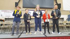 Eric J. Kos &nbsp&nbsp Alameda's top five spellers celebrate their achievements at last Saturday's spelling bee. Left to right: Benji Kapelke, fourth place; Kira Hannigan, fifth place; Ella Banchieri, first place; Elena Morishige, second place and Chandler Lau, third place.