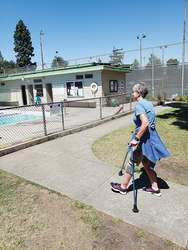 Eric J Kos &nbsp&nbsp Alameda resident Julie Lyons, seen here at the Franklin Park pool, gets around town just fine with her Bioness LG300-GO. Lyons suffers from multiple sclerosis.