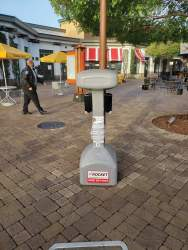 Eric J. Kos &nbsp&nbsp City staff has deployed hand-sanitizer stations at locations in town, one shown here at South Shore Center.