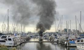 Roy Cockrell  A blaze aboard a boat docked at Grand Marina spread to a pair of neighboring vessels before firefighters arrived to extinguish it.