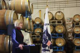 Dennis Evanosky  Nestled among barrels of aging wine at the Rock Wall Winery on Alameda Point, City Manager Jill Keimach spoke to a group of Chamber of Commerce members and their guests last Friday about the current state of the city of Alameda.