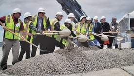 Dennis Evanosky &nbsp&nbsp Local officials gathered the shovels for a groundbreaking ceremony marking the start of construction on a mixed-use waterfront development on the former Naval Air Station Wednesday, May 23.