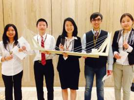 Megan Lam, Henry Zhu, Winnie Zhou, Zobeir Hamid, Sandy Evsanaa, show off their suspension bridge that won first place in a recent Engineering Alliance for the Arts competition. Photo by Carlton Grizzle