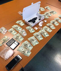 Courtesy Berkeley Police Department &nbsp&nbsp Berkeley Police confiscated this money, drugs and gun from an Alamedan in Berkeley last week.