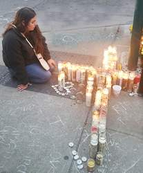 Photos by Dennis Evanosky &nbsp&nbsp&nbsp&nbsp A vigil on May 31 at Park Street and Webb Avenue recalled the Memorial Day accident that took the lives of Briana Ortega and Simon Sotelo: A young woman mourns at the candles placed on Webb Avenue, where the truck carrying Ortege and Sotelo came to rest