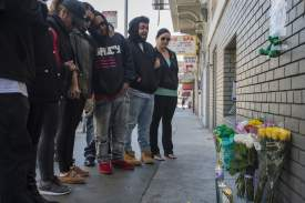 Jessica Christian/S.F. Examiner  Friends and family gather to set up a memorial for Joshua Mejia in San Francisco's Tenderloin District in San Francisco last Monday. Mejia was shot and killed near Geary and Polk streets in the early morning hours of Sunday, July 17.