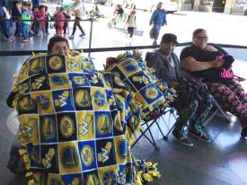 """Courtesy photo  On """"Swag Nite"""" at the Alameda Theatre & Cineplex, fans competed to see who could don the most Warriors attire. One fan came wrapped from head to toe, complete with a pillow."""