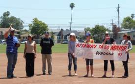 Courtesy photo  The parks department league launched its new season with a ceremonial pitch from Mayor Trish Herrera Spencer (second from left). Flanking the mayor were Dennis McDaniels of the Alameda Recreation and Parks Department and former Vice Mayor Lil Arnerich who helped relaunch the league. Lincoln Park volunteers hold the banner.