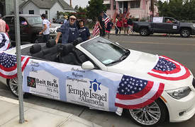 Courtesy photo &nbsp&nbsp&nbsp Temple Israel's Board President Genevieve Pastor-Cohen (right) and her husband, Josh Cohen, participated in this year's Fourth of July parade.