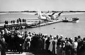 """Library of Congress &nbsp&nbsp Well-wishers look on as Pilot Ed Musick and his crew board China Clipper in Alameda on Nov. 22, 1935, for their historic flight to Manila. Note that the numbers on the wing end with 16. This gave the plane its nickname """"Sweet 16."""""""