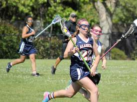Danielle Simpson cruises past a Petaluma defender in Alameda Attack's 12-4 victory earlier this season. Courtesy photo.
