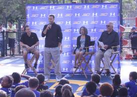 Golden State Warriors Point Guard Stephen Curry stands and speaks to about 30 youngsters at Leydecker Park Monday. The Alameda Recreation and Parks Department and Under Armour worked together to refurbish the park's basketball court, since renamed Curry Court. Along with Curry, left to right, a representative of sponsor Under Armour, Mayor Marie Gilmore and recently installed Parks Commissioner Mario Mariani, who was instrumental in getting the project off the ground, also spoke.