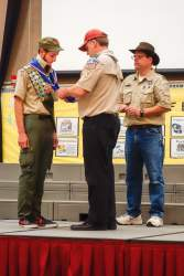 Scout Master Chris Freck awards Kevin Mercado the Eagle Scout  neckerchief he earned in 2012.