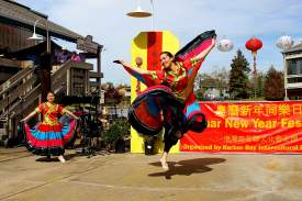 "Courtesy photo Patty Chu's Chinese Folk Dance Troupe performed graceful traditional dances of China as part of the 2014 Lunar New Year Festival on Bay Farm Island. Pictured is Emily Lam performing a Yi Minority dance called ""Flying Skirts."""