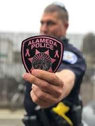 Courtesy APD &nbsp&nbsp Grab a cool pink Alameda Police Department patch and support breast cancer patients at the same time.