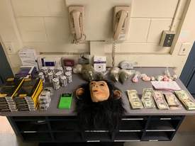 Alameda Police Department &nbsp&nbsp A crime desk at Alameda Police Department was almost completely covered with evidence from a recent bust in Alameda. A suspect already on probation was detained after a large quantity of drug, cash and even a monkey mask were found in his car.