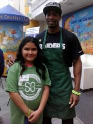 Photos courtesy Minerva Perez, Marianna Martinez poses with Raiders Wide Receiver Rod Streater just prior to having her head shaved for charity.