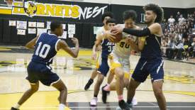 Henry Chao &nbsp&nbsp Alameda Junior Jason Cibull aggressively drives into the paint in the Hornets' victory over the Encinal Jets last Saturday.