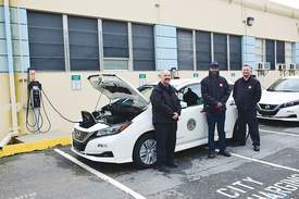 City of Alameda &nbsp&nbsp Three members of Alameda Fleet Services from left to right: Daniel Olberg, Lee Morris and Forrest Heiderick stand in front of a zero-emission 2019 Nissan Leaf.