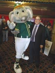 File photo &nbsp&nbsp City Manager Eric J. Levitt buddied up with A's mascot Stomper at a town hall meeting to discuss the team's new stadium with Alamedans in May.