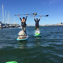 Courtesy Mary Spicer &nbsp&nbsp Amy Mosbey, a stand-up paddle yoga instructor in Alameda and elsewhere, and her family volunteered to help Alamedan Mary Spicer's effort to clean the Oakland estuary last year. Spicer will lead another clean-up effort this Saturday, Sept. 21.