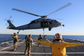 Chief Petty Officer Matthew Masaschi &nbsp&nbsp Lt. j.g. Michelle McGill serves as a Landing Signal Officer aboard the Coast Guard Cutter Munro as Coast Guard Maritime Security Response Team West servicemembers conduct fast-rope exercises from a U.S. Navy Helicopter