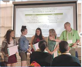 Courtesy CASA &nbsp&nbsp Left to right, Alameda High School Senior Caroline Choi, Haley Organ of New York and Johanna Reimer of Massachusetts receive awards from Robin Buchanan of Project Green Schools and Stephen Ritz of Green Bronx Machine.
