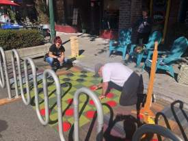 Courtesy WABA &nbsp&nbsp The giant checkers game installed in a Webster Street parking spot for just one day on Park(ing) Day was a hit with locals.