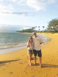 """Courtesy photo &nbsp&nbsp Sarah and Devin Hobbs on a beach in Maui just before Easter and Sarah's discovery of the """"Aloha Wallet"""""""