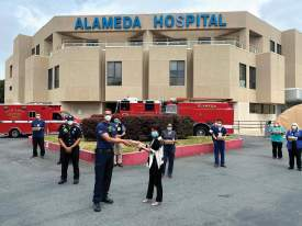 Courtesy photo &nbsp&nbsp Alameda firefighters volunteered to deliver fresh meals from local restaurants to medical workers at Alameda Hospital April 29.
