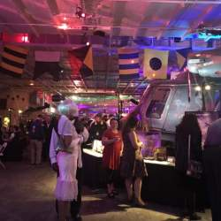 Courtesy photo.    A scene from a previous New Year's Eve celebration aboard the USS Hornet shows guests mingling among the exhibits.