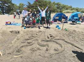 """Courtesy ARPD &nbsp&nbsp The Peralta family of Alameda celebrates their first-prize winning sand sculpture """"Octopus."""" The entry earned first place in the family category."""