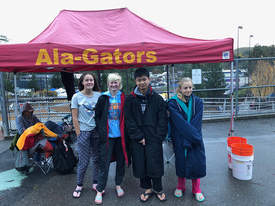 Alba Barber &nbsp&nbsp Members of the Alameda Gator swim team: (left to right) Zoey Kuhn, Molly Boyle, Devin Hou and Sydney Thompson competed at the Winter 14-and-Under Short Course Junior Olympics last month in Moraga.