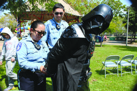 Mike Lano &nbsp&nbsp Harbor Bay Isle Security arrested Darth Vader for crimes against the universe at the Tillman Park annual picnic Saturday.