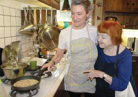 File photo &nbsp&nbsp Weezie Mott, right, working with culinary consultant Rosemary Mark in her kitchen last year.