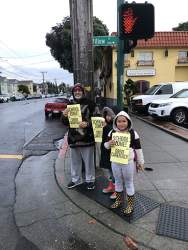 Sarah Burningham.  Parents and students at Love Elementary School rallied at key intersections to remind drivers to slow down near schools. Above, one family volunteered at the corner of Willow Street and Lincoln Avenue.