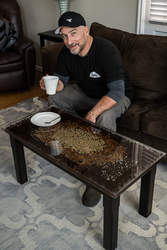 Mike Rosati &nbsp&nbsp Mike Muzio of Alameda puts his coffeetable made of coffee to good use — drinking coffee. The public can check it out at this Sunday's Alameda Mini-Maker Faire.