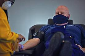 Petty Officer 2nd Class Brandon Giles/Released) &nbsp&nbsp 11th Coast Guard District Command Master Chief Shane Hooker, donates blood at an American Red Cross event for military personnel at Coast Guard Base Alameda on April 7.