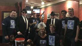 "Courtesy photo &nbsp&nbsp Alamedan Andy MacKay, the man behind the pipes and the Pipe-a-thon, receives some help from ""Joliet Jake"" and Elwood Blues, along with several other volunteers each New Year's Eve to raise funds to fight cancer."