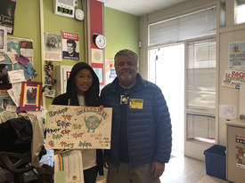 "Photo by Veronica Rylander &nbsp&nbsp Poet Laureate Gene Kahane (right) and Penny Chai, an eighth grader at Lincoln Middle School, celebrate Chai winning the 2019 Everyone Belongs Here Poster Contest (the seventh annual). The theme was ""every pronoun belongs here."" Chai's poster will be on display at the Alameda Unified School District offices. The district will make copies for all classes in the fall. The poster contest was accompanied by an Everyone Pronoun Belongs Here poetry contest."