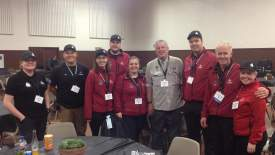 Courtesy photo  Alamedan Randy Lantz (center) poses with part of the Iceland Search and Rescue team in their red jackets at the recent SARCON.