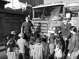 Courtesy photos &nbsp&nbsp An Alameda firefighter describes the equipment on one of the fire engines to a group of local kindergarten students.