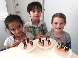 Photos by Robin Seeley  Leila, Roan, and Abby show off handmade edible penguins that are actually skating around on their own little melting ice caps.