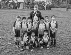 Adam Garfinkle &nbsp&nbsp The Alameda Islander Under-nine team pose with their silver trophy after their 4-3 defeat in the NorCal State Cup Premier Division Four championship game. The squad took down two opponents before the title match.